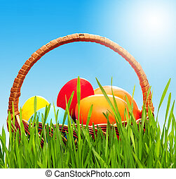 Wicker basket with eggs - Wicker basket with easter eggs in...