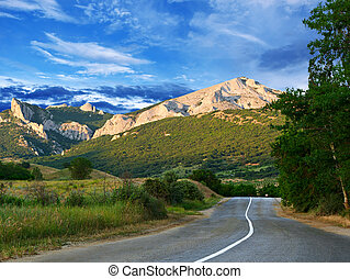Road, mountains and blue sky - Road against mountains and...