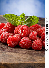 Raspberries - photo of delicious red raspberries with mint...