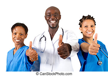 doctor and nurse giving thumbs up - group of african doctor...