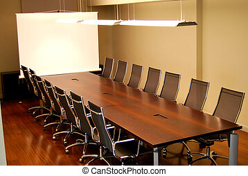 Meeting table - A business meeting room with chairs and...