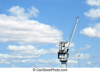 Big crane - A harbour crane silhouette against the blue sky