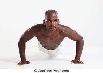 african american man push up - muscular young african...