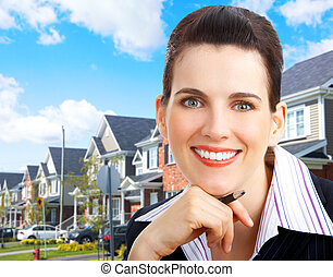 Real estate agent - Smiling business woman. Real estate...