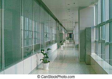 Office building hallway - Long hallway in the modern office...