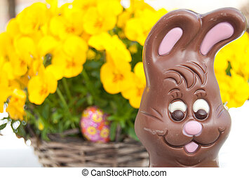 Easter bunny in front of flowers. In the flowers. In the...