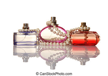 Perfume in a glass bottles and pearl beads on white...