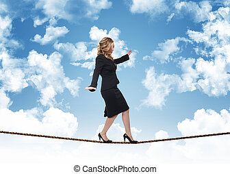 woman on rope and blue sky with clouds