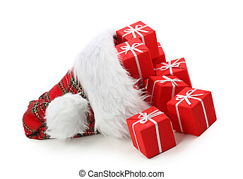Santa claus hat with christmas presents isolated on white...