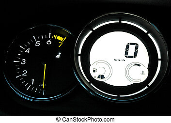 Speedometer and tachometer on dashboard