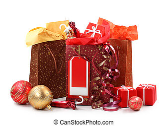 Three shopping bags with presents isolated on white...
