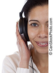 close-up of a happy woman enjoying with headphones music