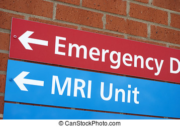 Hospital sign - Sign of wall of hospital pointing to...