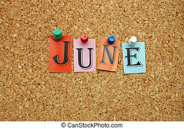 June, month pinned on noticeboard