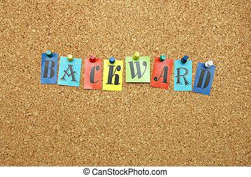 Backward pinned on noticeboard