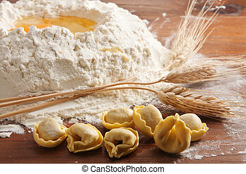 Preparing Tortellini - Tortellini pasta with wheat and flour