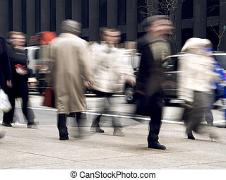 Business Rush - A motion blur of business people on the...