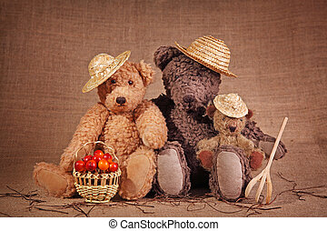 Three teddy bears in autumn