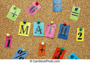 Mathematical symbols pinned on noticeboard