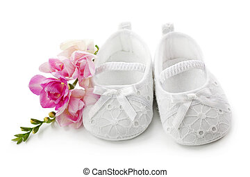 Baby girl shoes with pink flowers isolated on white...