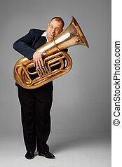 Tubaist - Musician playing the tuba