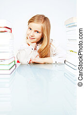 smiling girl with books in library