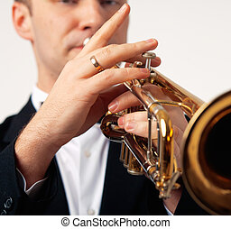 Portrait of a man playing his Trumpet
