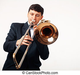 The Trombonist - Young man playing his trombone