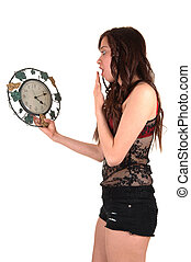 Girl with clock - A young woman, holding a clock and sees...