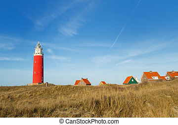 Red lighthouse at the Dutch island Texel