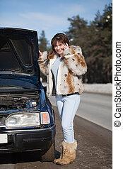 Woman waiting support near her broken car