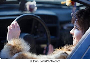 female driver in her  car