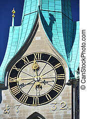 Ancient clock on top of Fraumunster church in Zurich