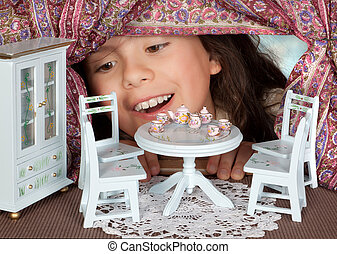 Tea in a dollhouse - Alice in wonderland looking into a...