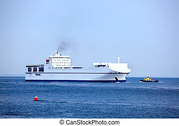Freight ship at sea - White freight cargo ship for...