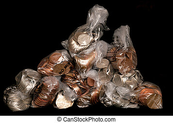 Pile of sterling coins in money bags studio cutout