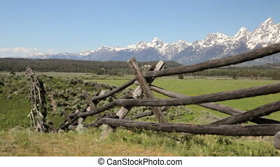 Grand Tetons and split rail fence 1 - Crane shot of...