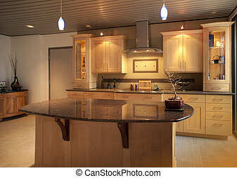 Kitchen in modern home or apartment with sleek warm wood...
