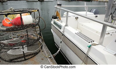 Crab Pots and Fishing Boat - Stack of empty crab pots and a...