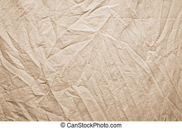 Background of crumpled dense fabric colored in beige tones