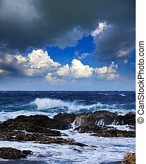 Sea wave breaking against rock - Sea wave breaking against...