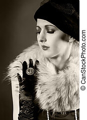 Retro styled fashion portrait of a young woman in gloves....