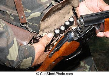 belt of ammunition on the belt of the hunter