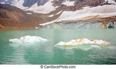 Melting Angel Glacier - Chucks of ice floating in glacial...