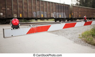 Railroad Crossing Barrier - Freight train crossing with high...