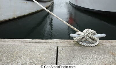 Moored Boats - Two boats tied to mooring cleats, dolly shot