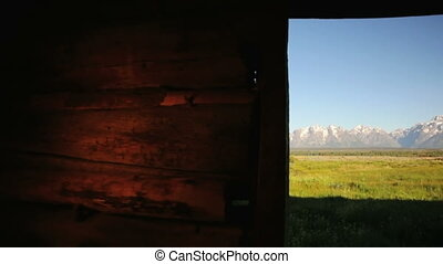 Grand Tetons from Old Pioneer Log Cabin