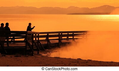 Sunrise Silhouettes in Yellowstone - Silhouette of tourists...