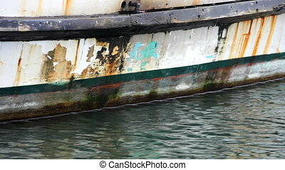 Old Fishing Boat - Rust stained and well worn fishing boat,...