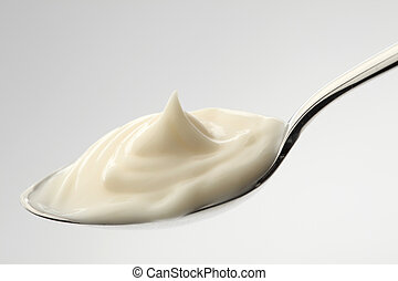 mayonnese - mayonnaise on a spoon with white background